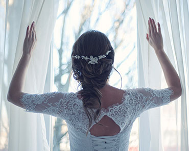 teaser image - wedding bride window